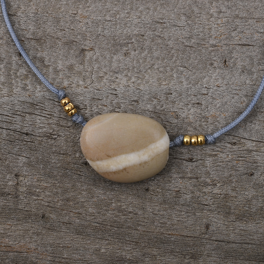 Beige pebble bracelet with white stripe